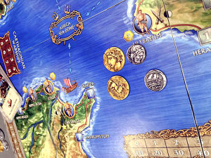 Great shot of the art for the coins. The final version of the tokens will have jagged edges.